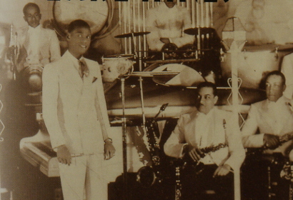 Image of L-r. George Dixon, Earl Hines, Wallace Bishop, Omer Simeon, Jimmy Mundy at the Grand Terrace Cafe, Chicago, 1932.